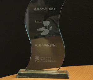 Symbolet på Årets Galoche med A. P. Hansens navn graveret ind.